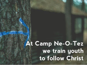 At Camp Ne-O-Tez we train youth to walk with Christ tree with arrow