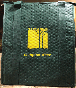 green insulated tote with yellow Ne-O-Tez logo Gold Ambassador membership gift